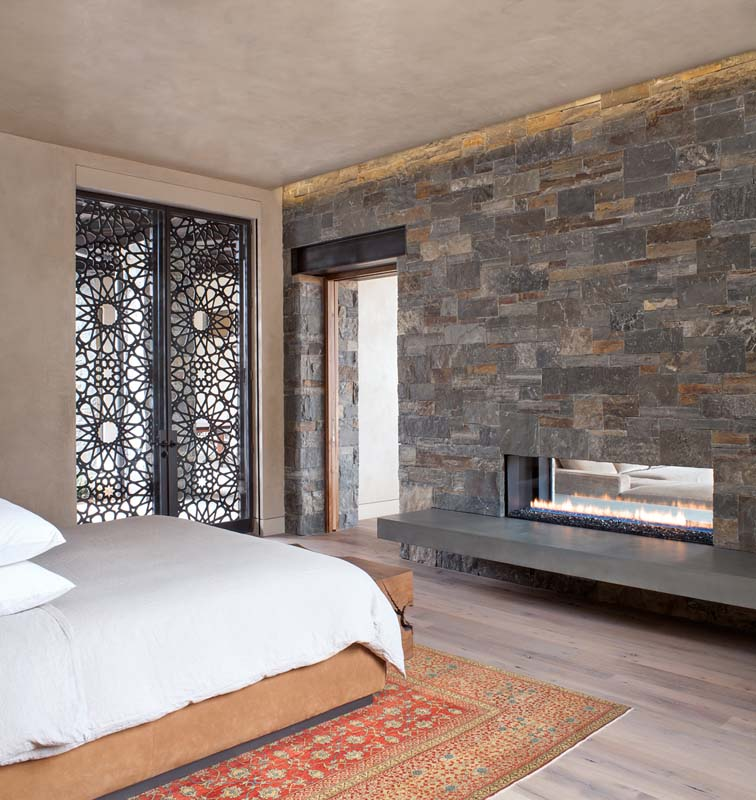 custom bedroom fireplace and rock wall