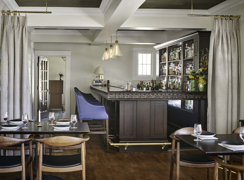 bar with blue leather stools chosen by stel house and home