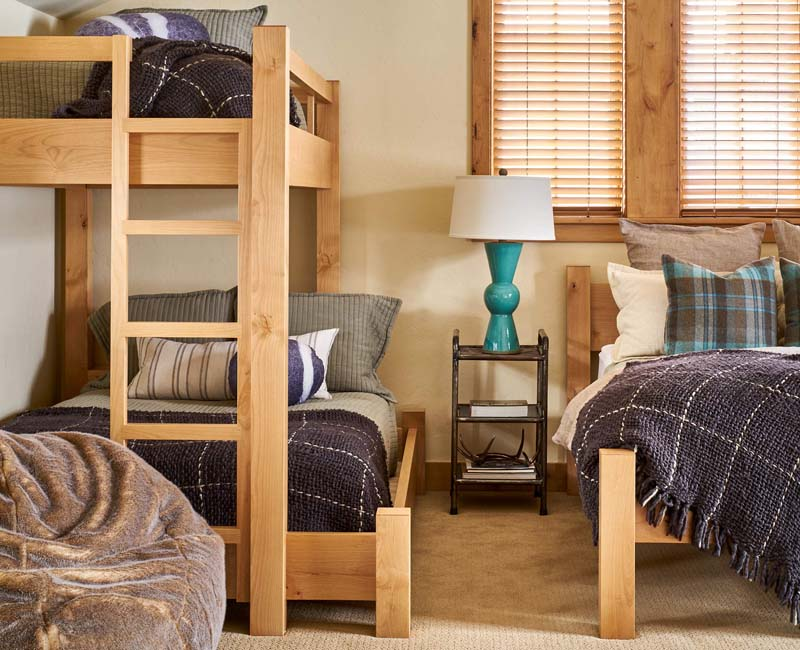 lamp and bedside table bunk beds and textured bedding